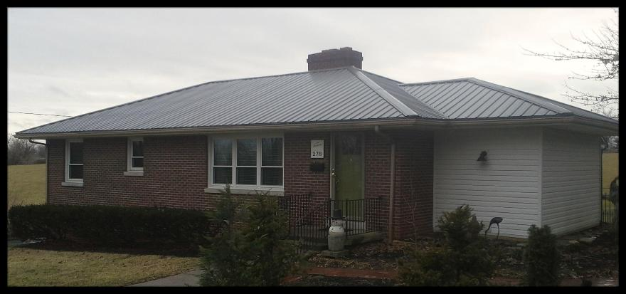 1 40 year charcoal metal roofing on a hip roof house for Metal hip roof